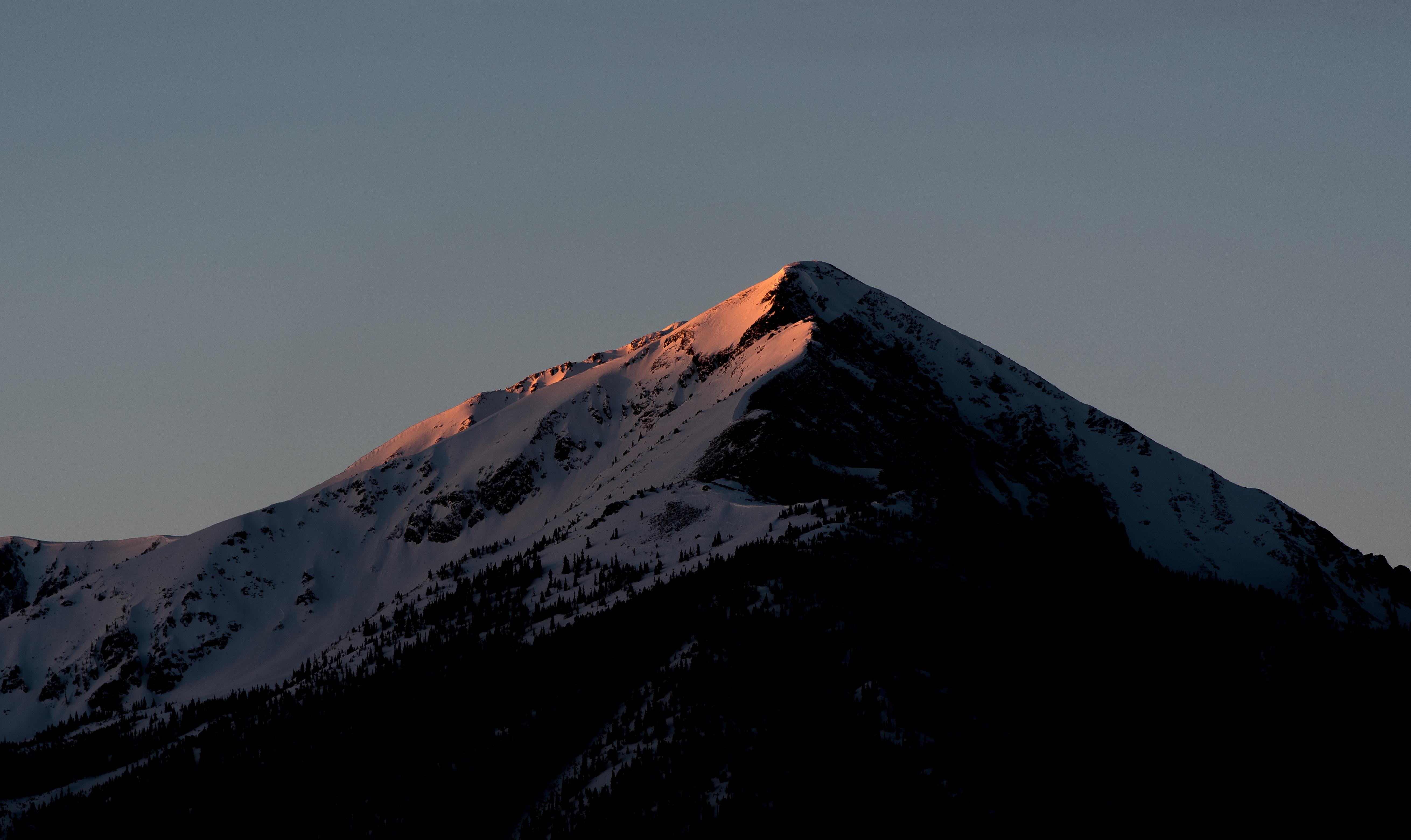 snow-capped mountain under dark sky