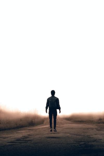 Figure walking on road
