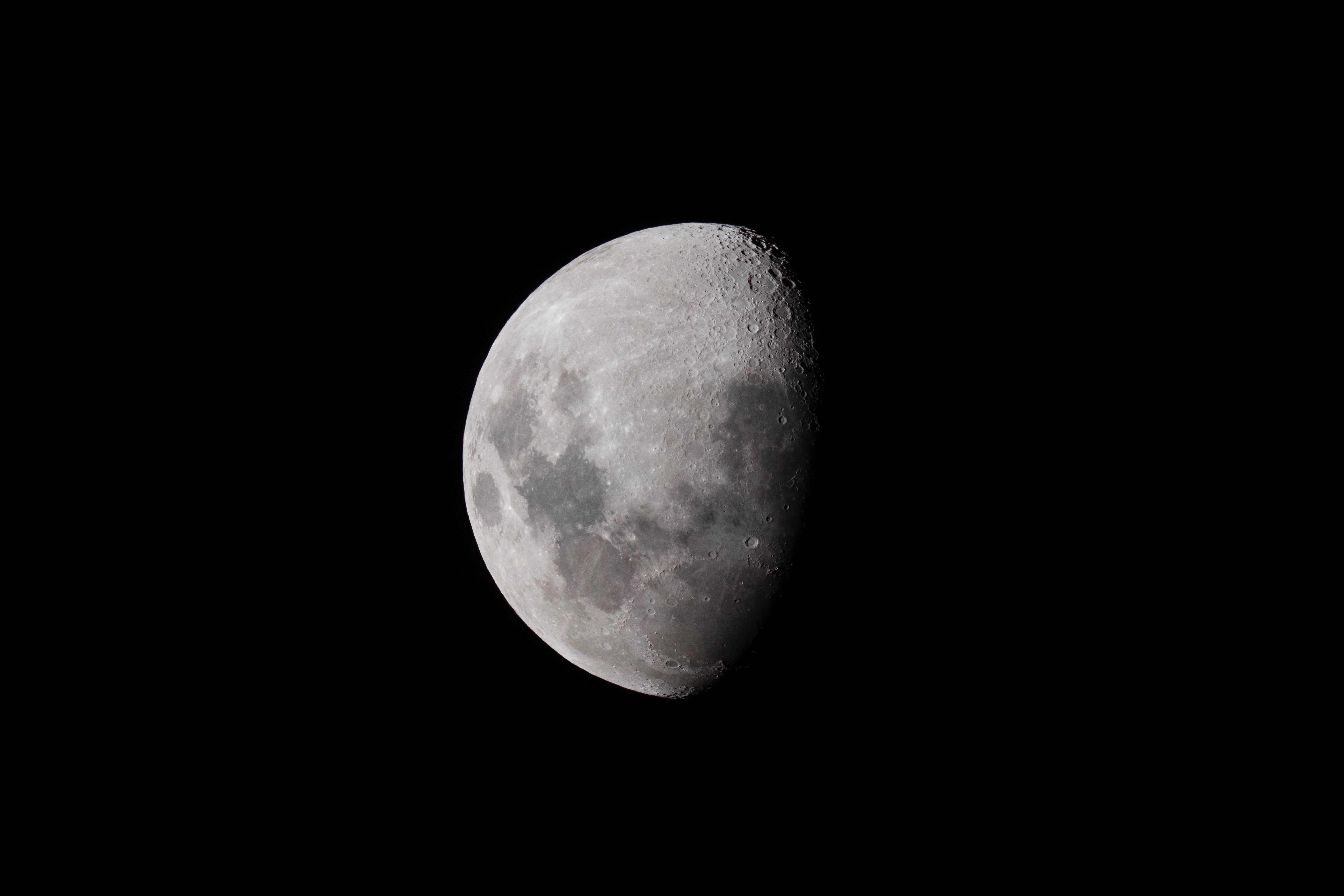 Lunar craters visible on the moon on the night sky at Otago Peninsula