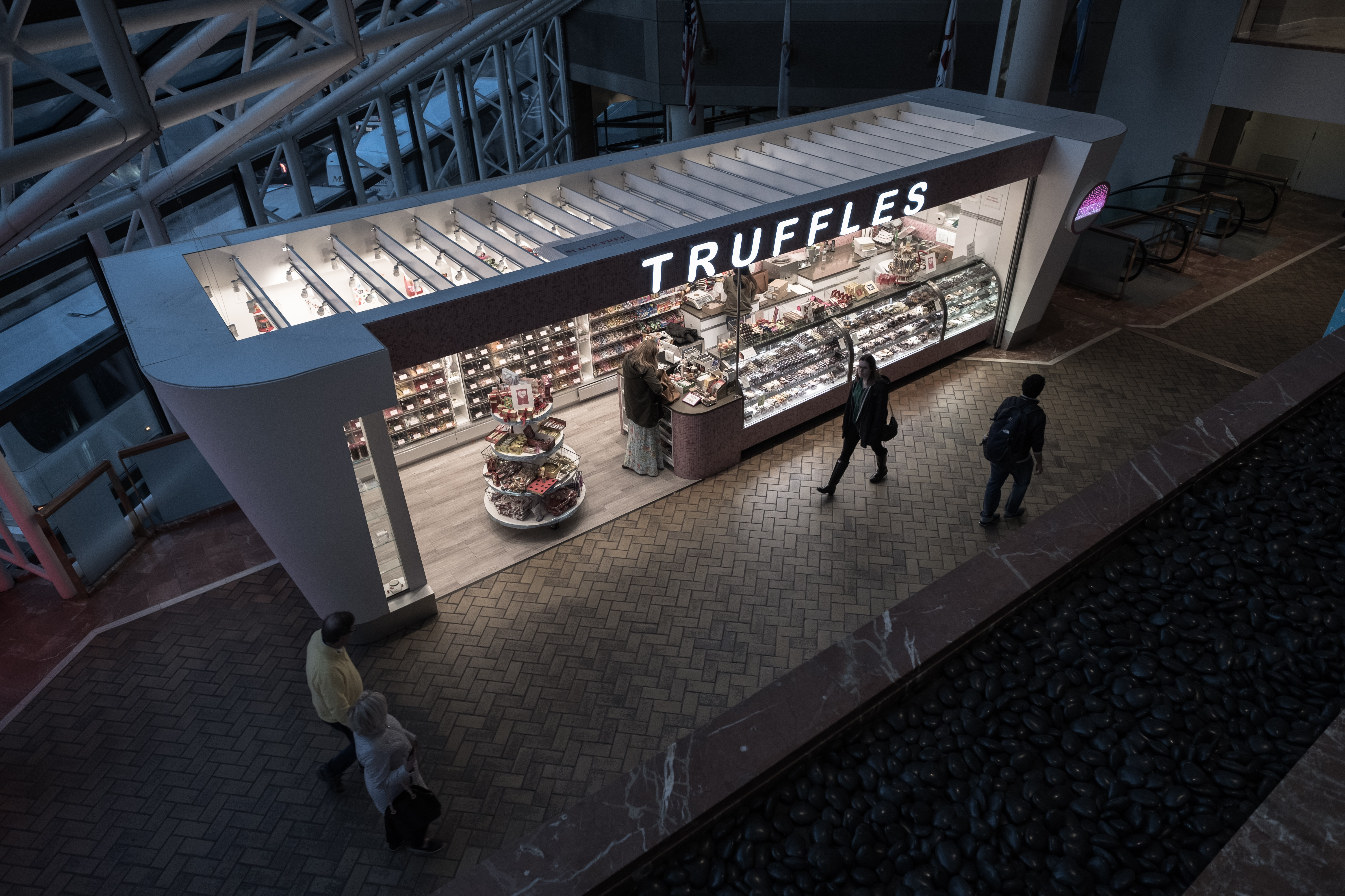 Outdoor truffle shop at a mall in Boston at night