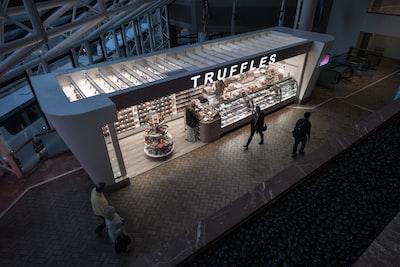 people walking beside Truffles store