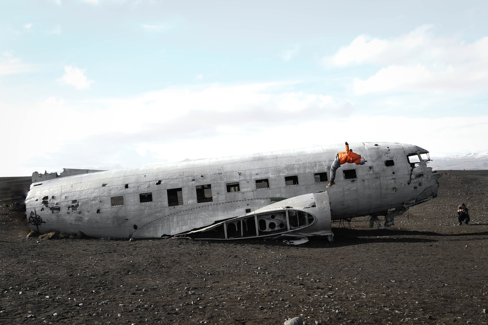 person doing back flip on wrecked plane