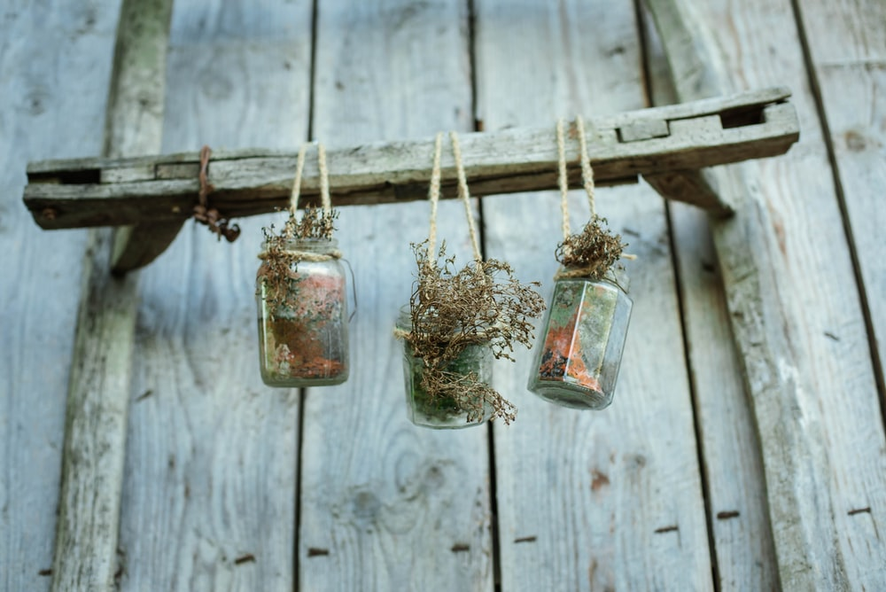 clear glass jar hanging on wall