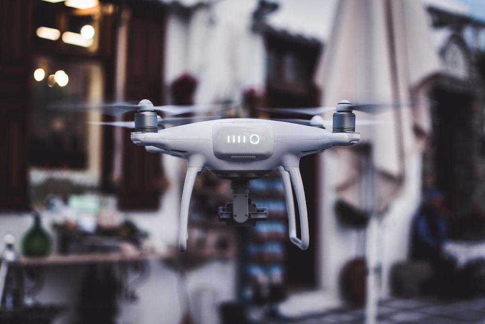 tilt shift lens photography of gray Phantom drone