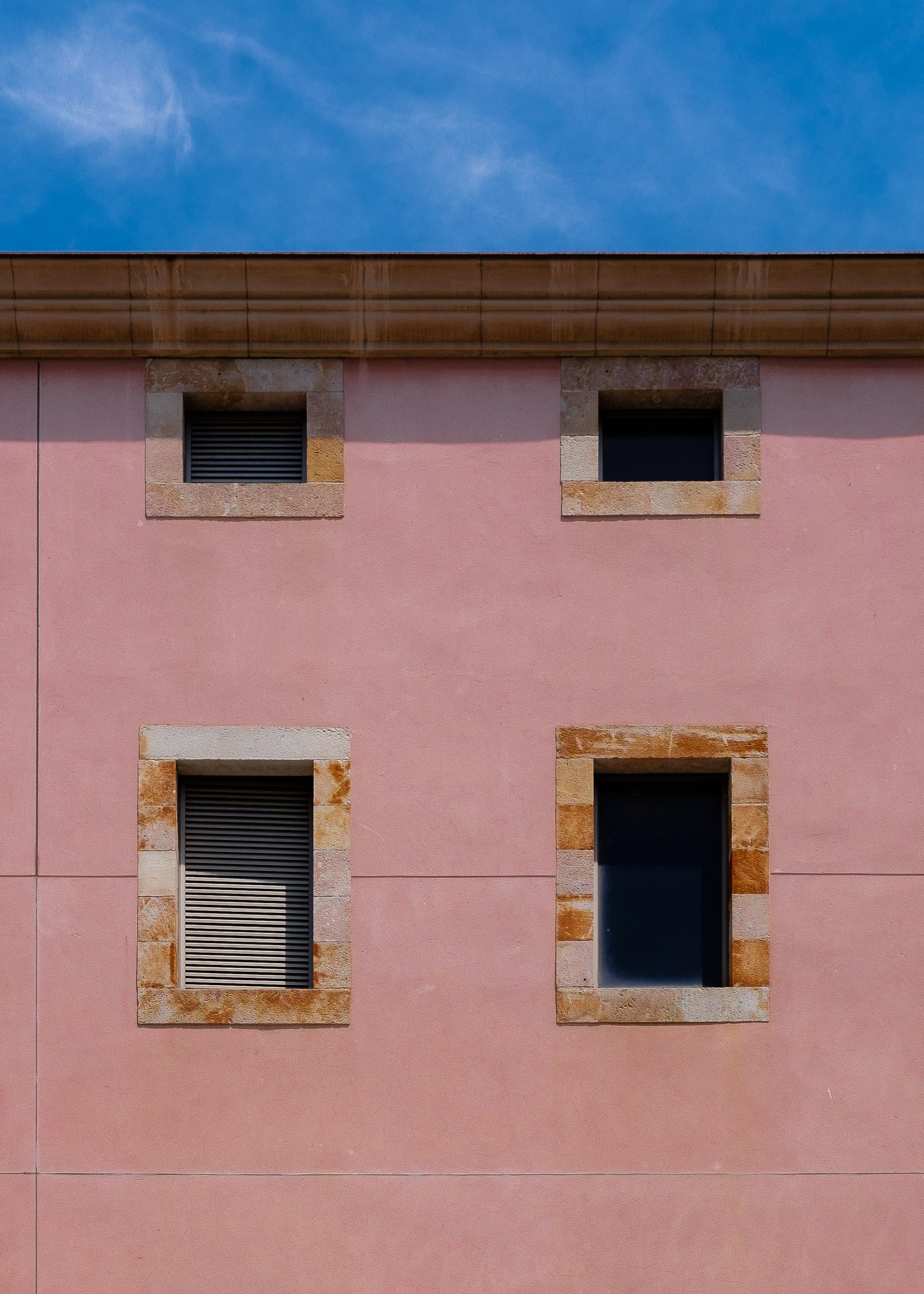 minimalist photography of concrete building with four windows