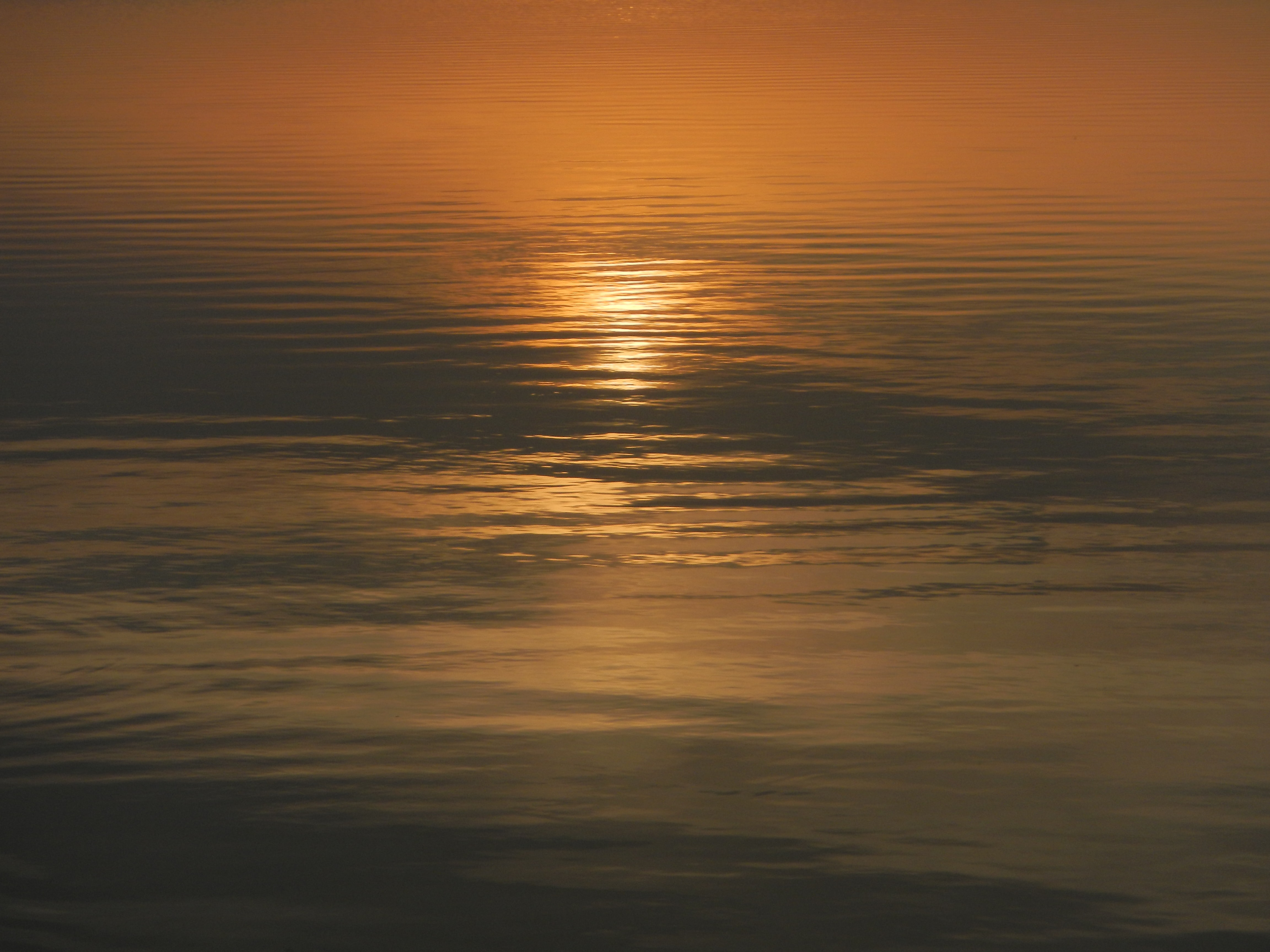 Setting sun reflected in the surface of the sea