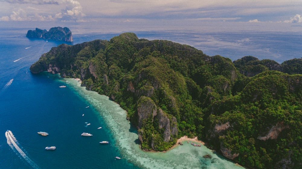 aerial photography of island under blue sky