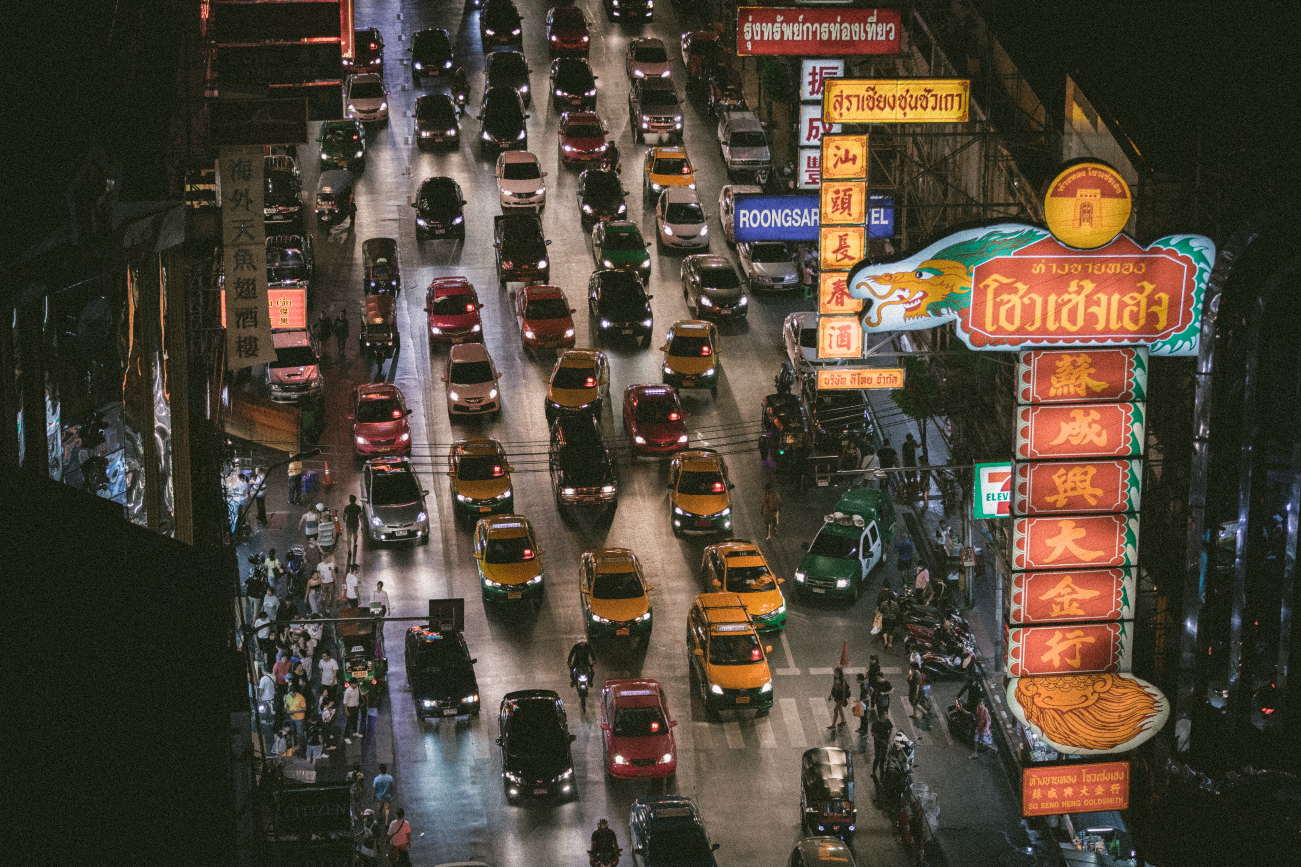 A drone shot of congested night traffic in Chinatown.