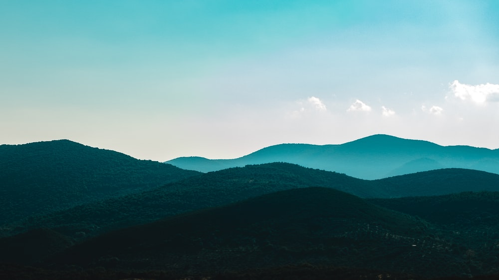 landscape photography of green mountain