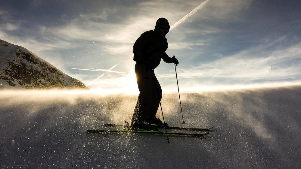silhouette of man doing ski
