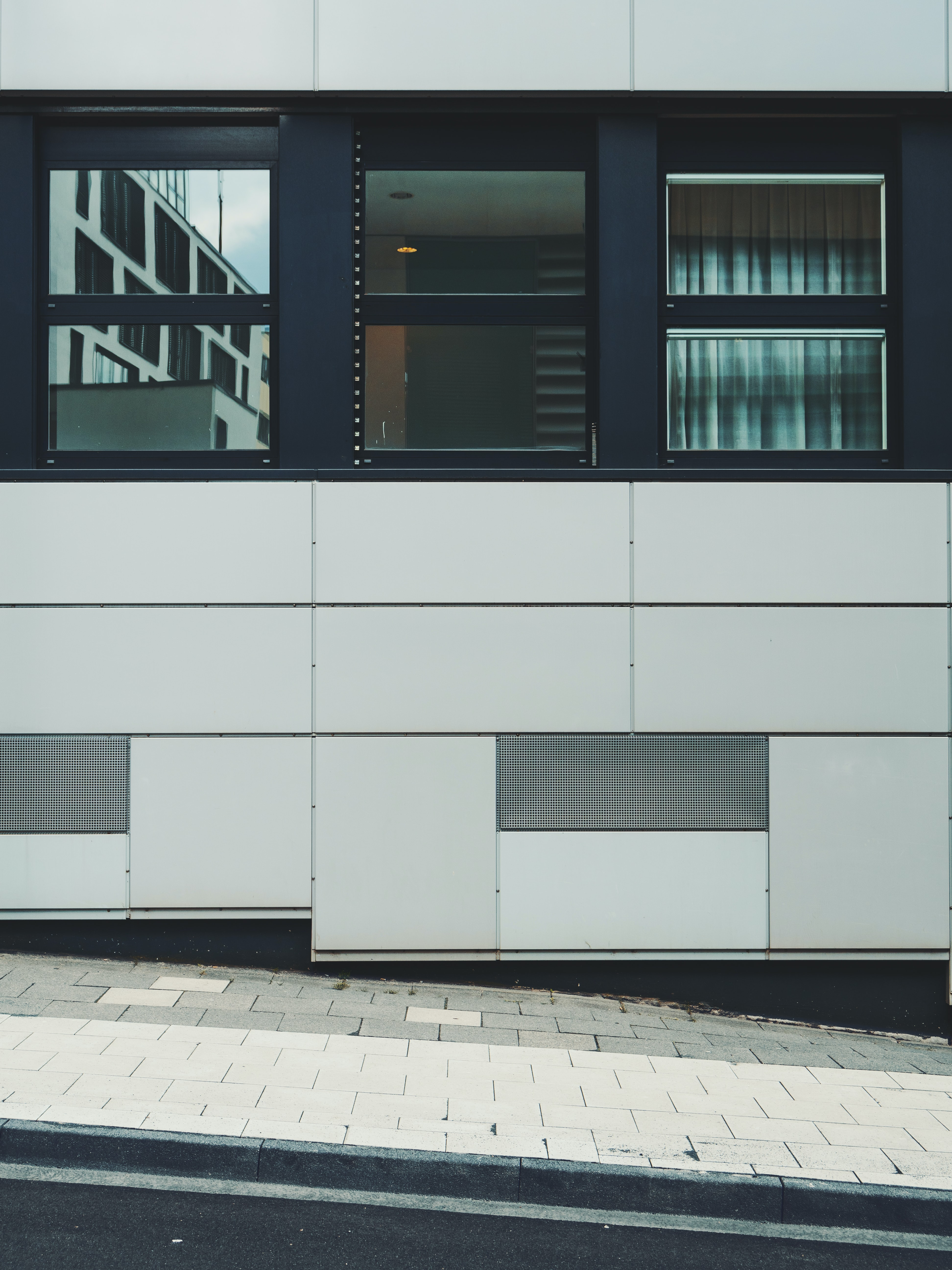 white and black concrete building at daytime