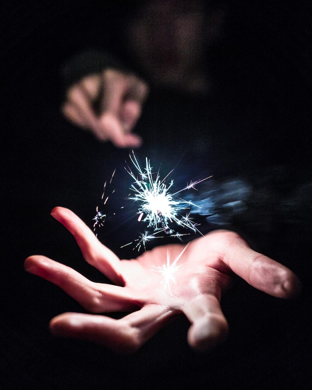 person holding sparkler