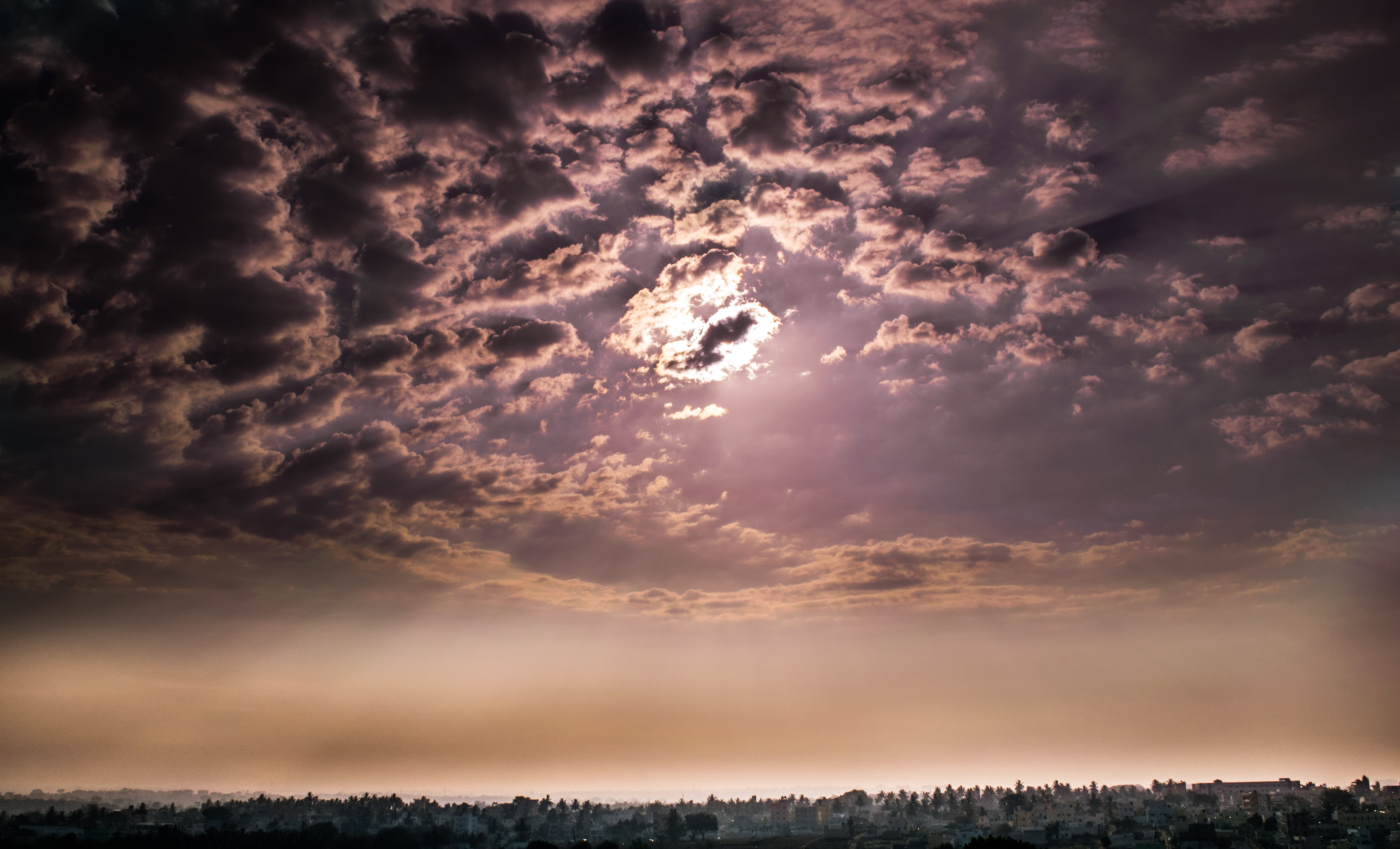 sun covered by cloudy sky