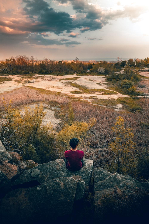 man siting on rocks