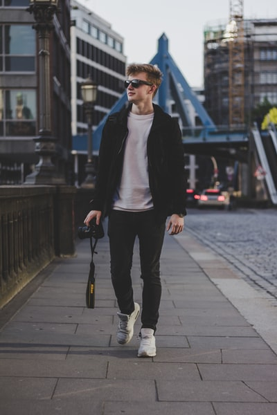 Man walking with a camera
