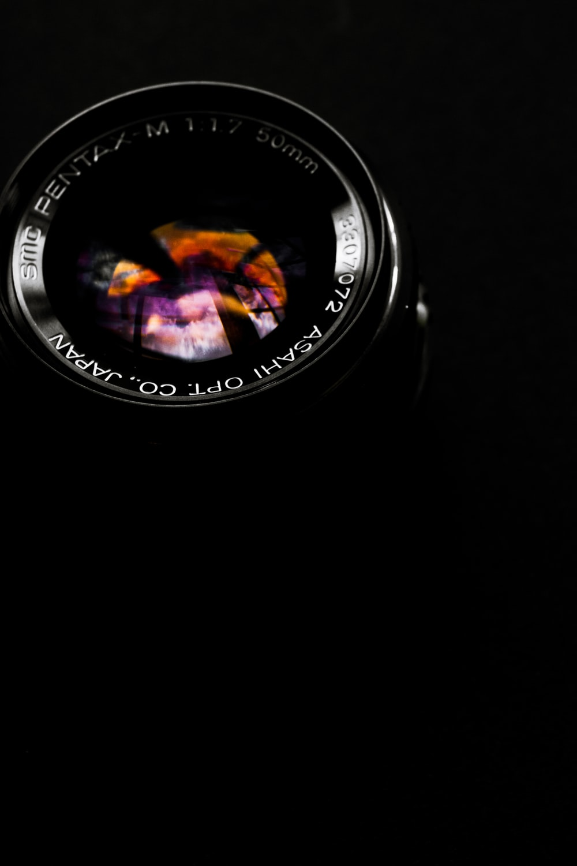 black telephoto lens on black surface