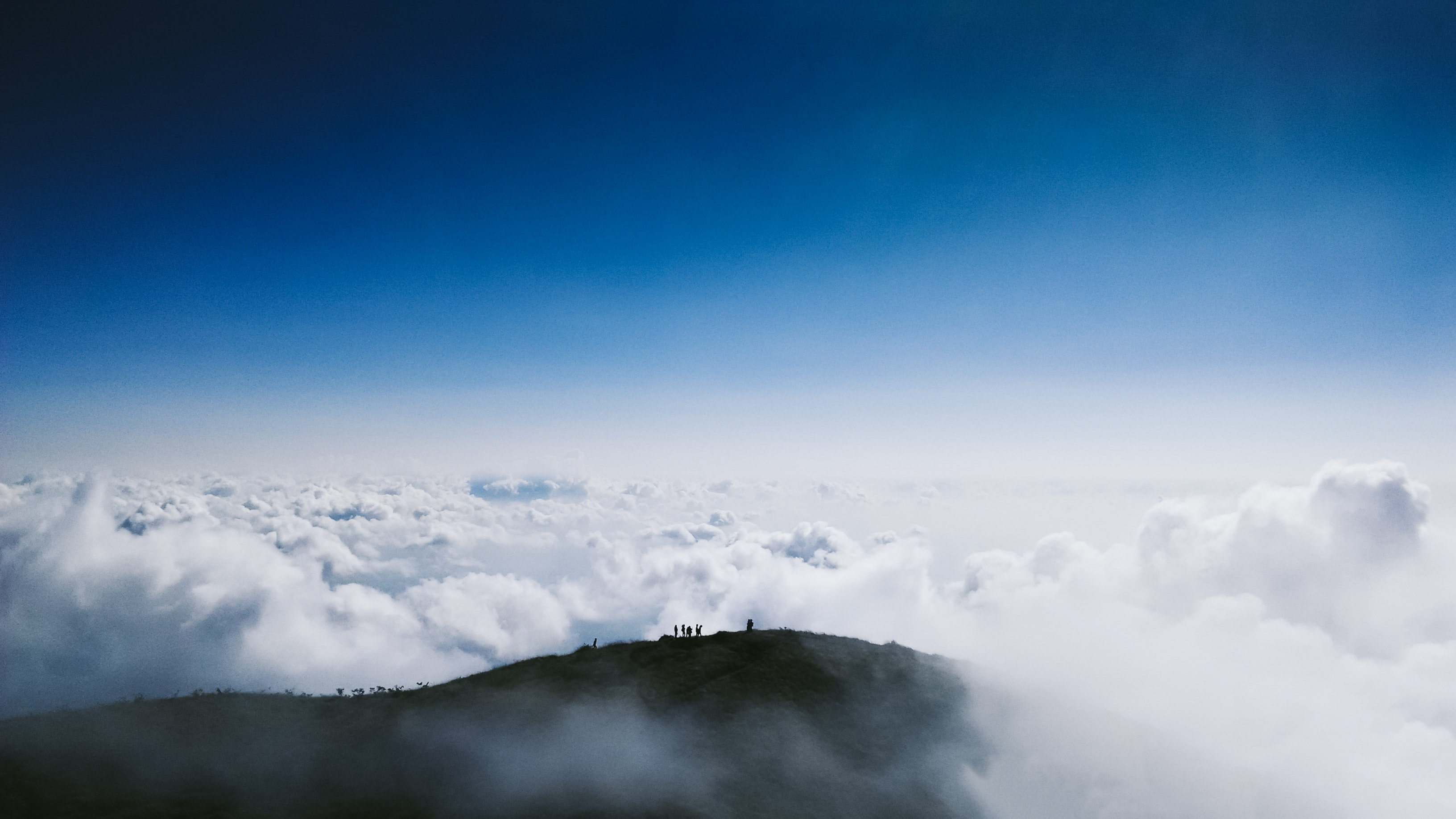 aerial photo of mountain reaching clouds