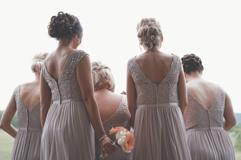 bridesmaids wearing gray gowns