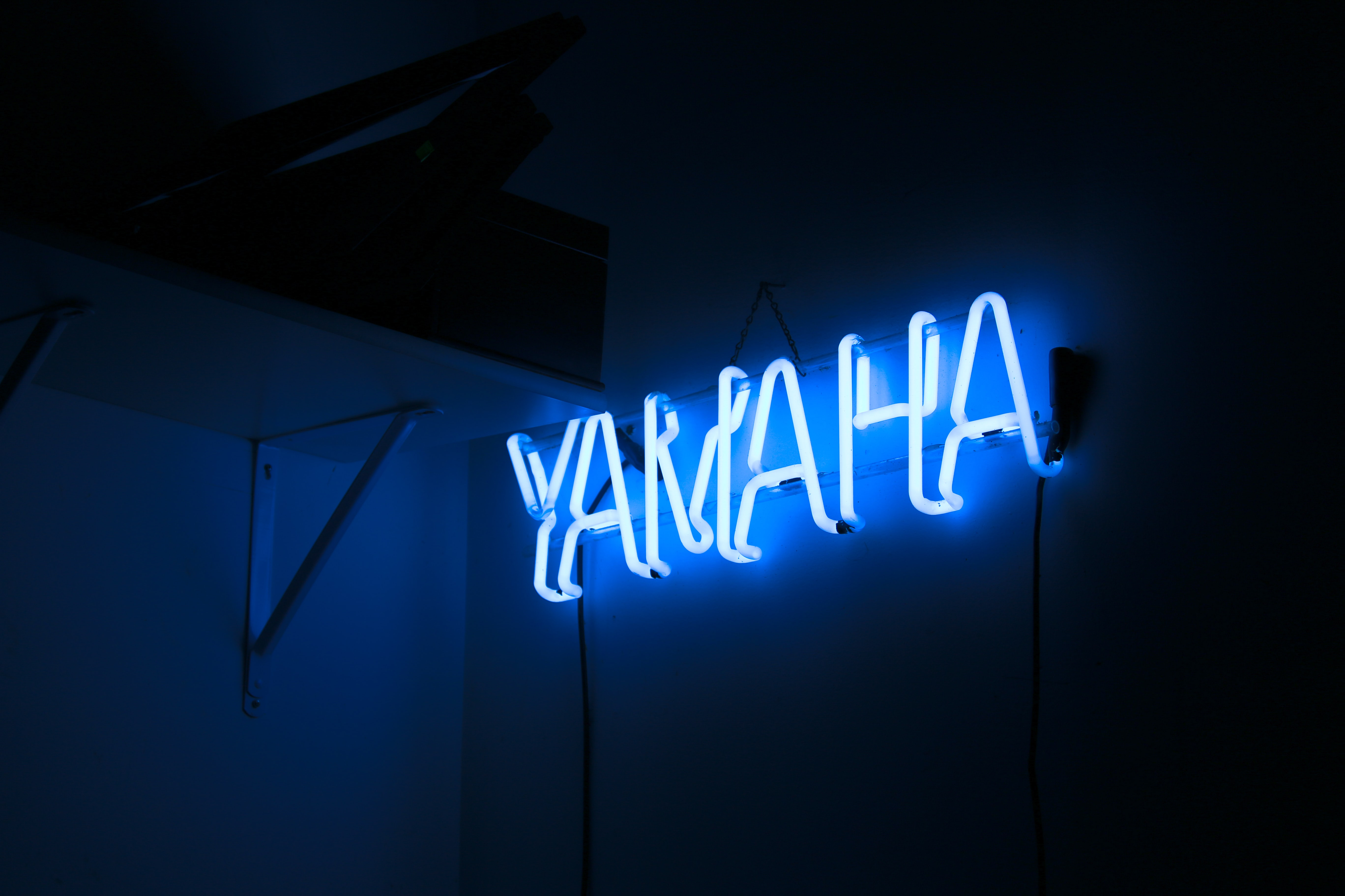 Yamaha neon light signage in the dark