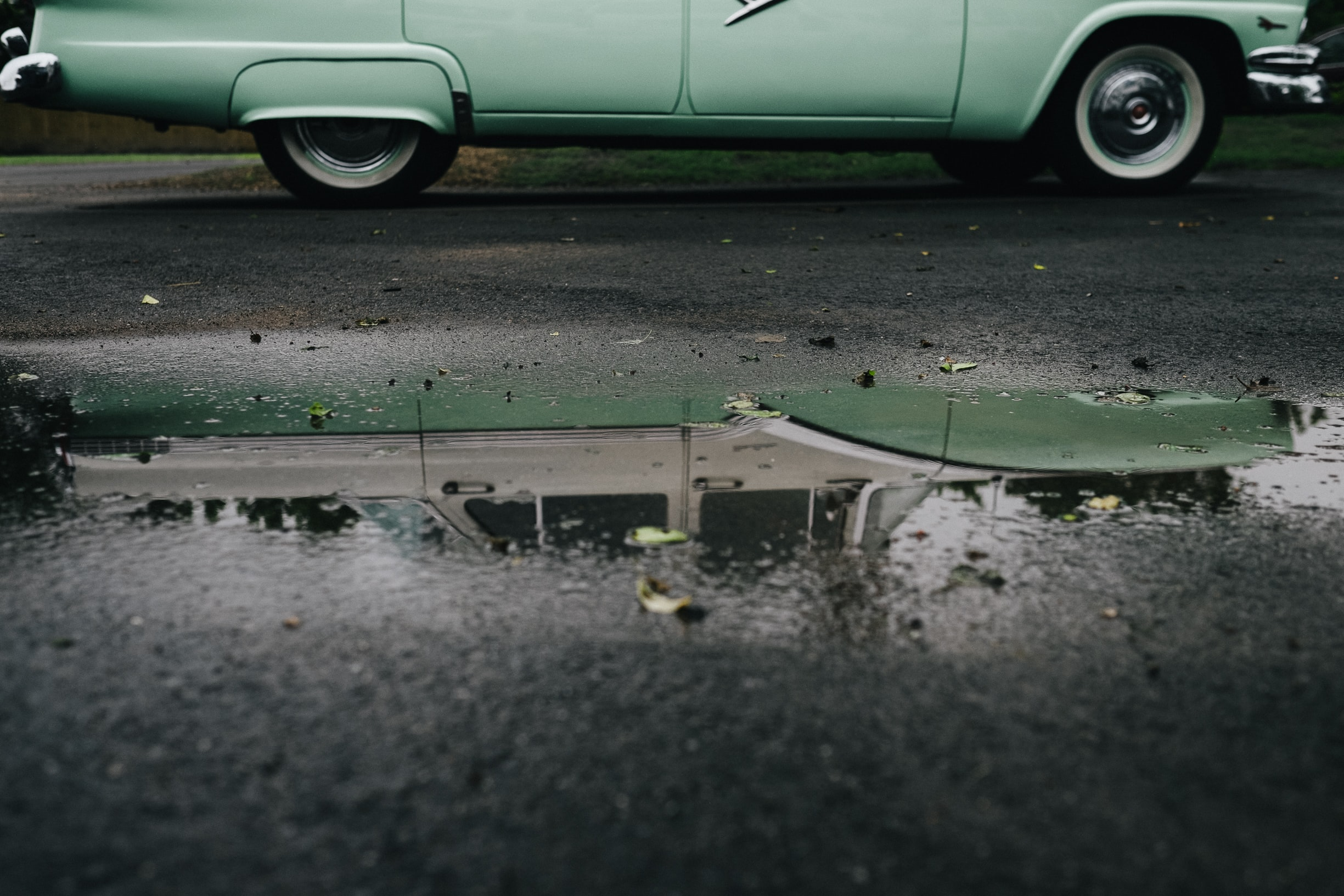 green car in the road