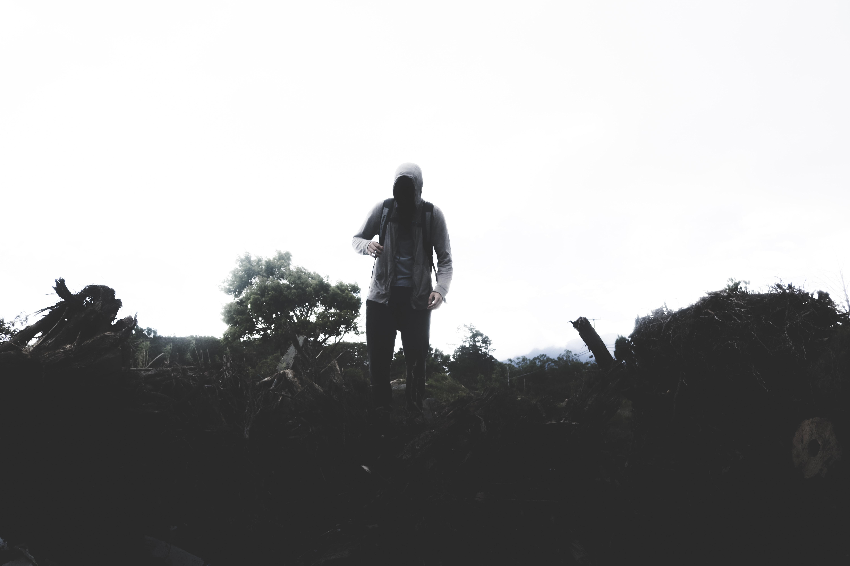 person wearing hoodie standing on field