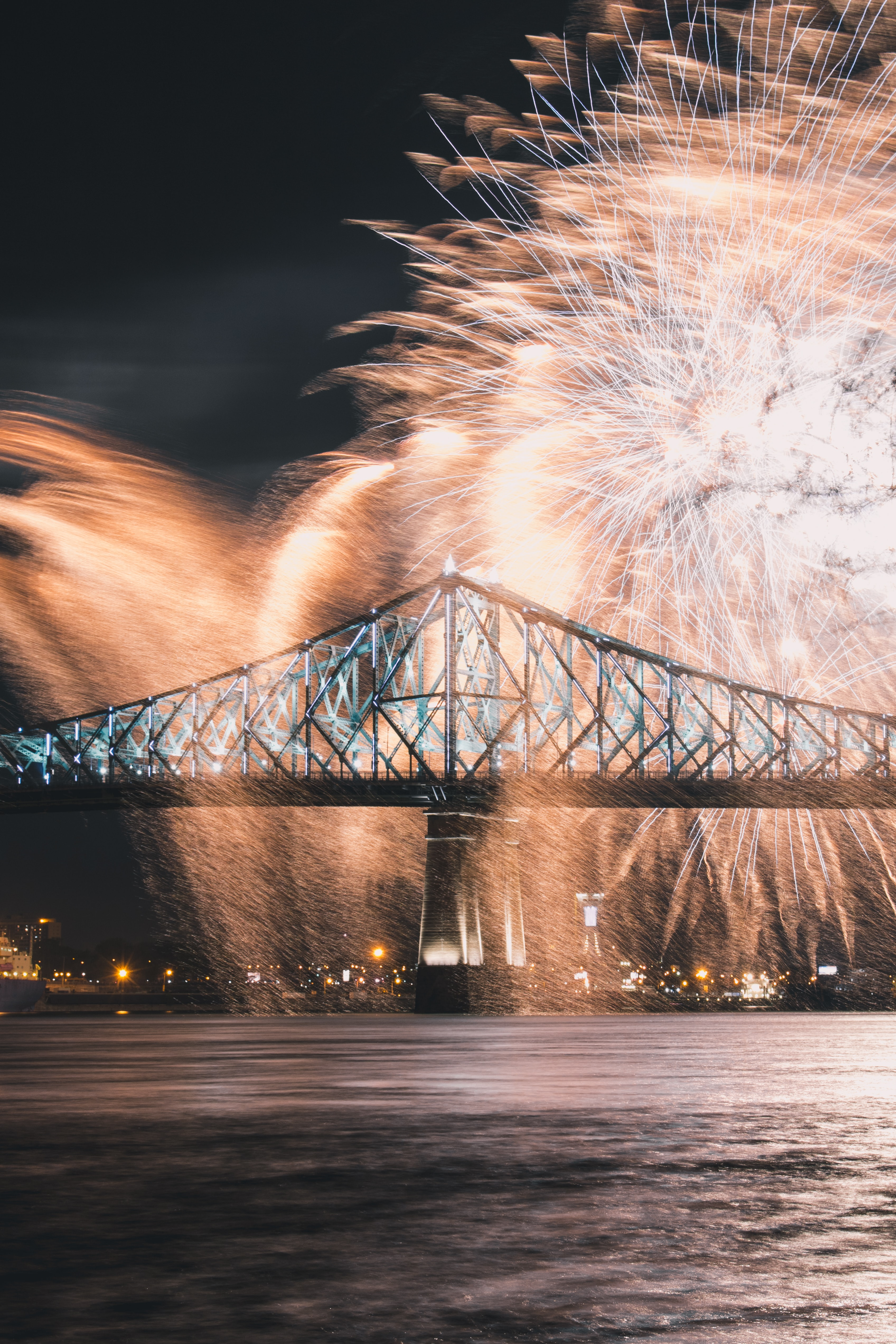 time lapse photography of fireworks over bridge