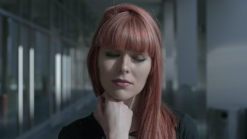 velvet-haired woman closing her eyes