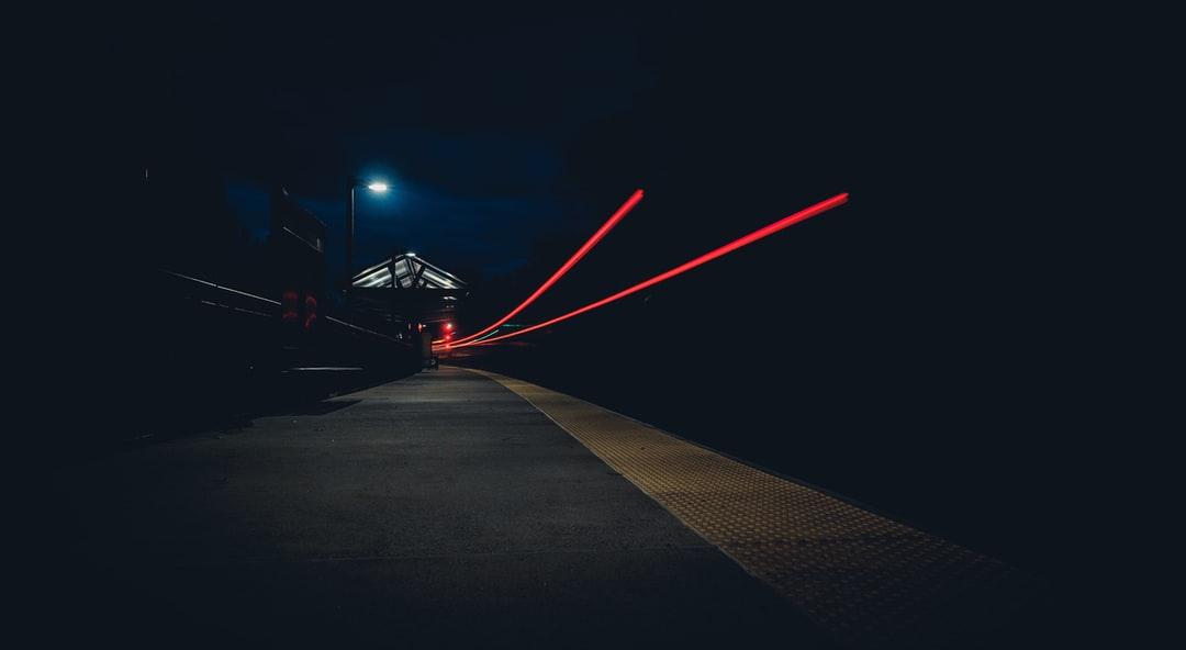 Two red light trails at night