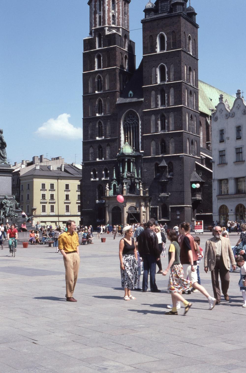 people standing beside concrete cathedral
