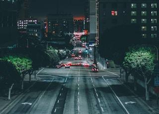 cars on gray asphalt road during nighttime