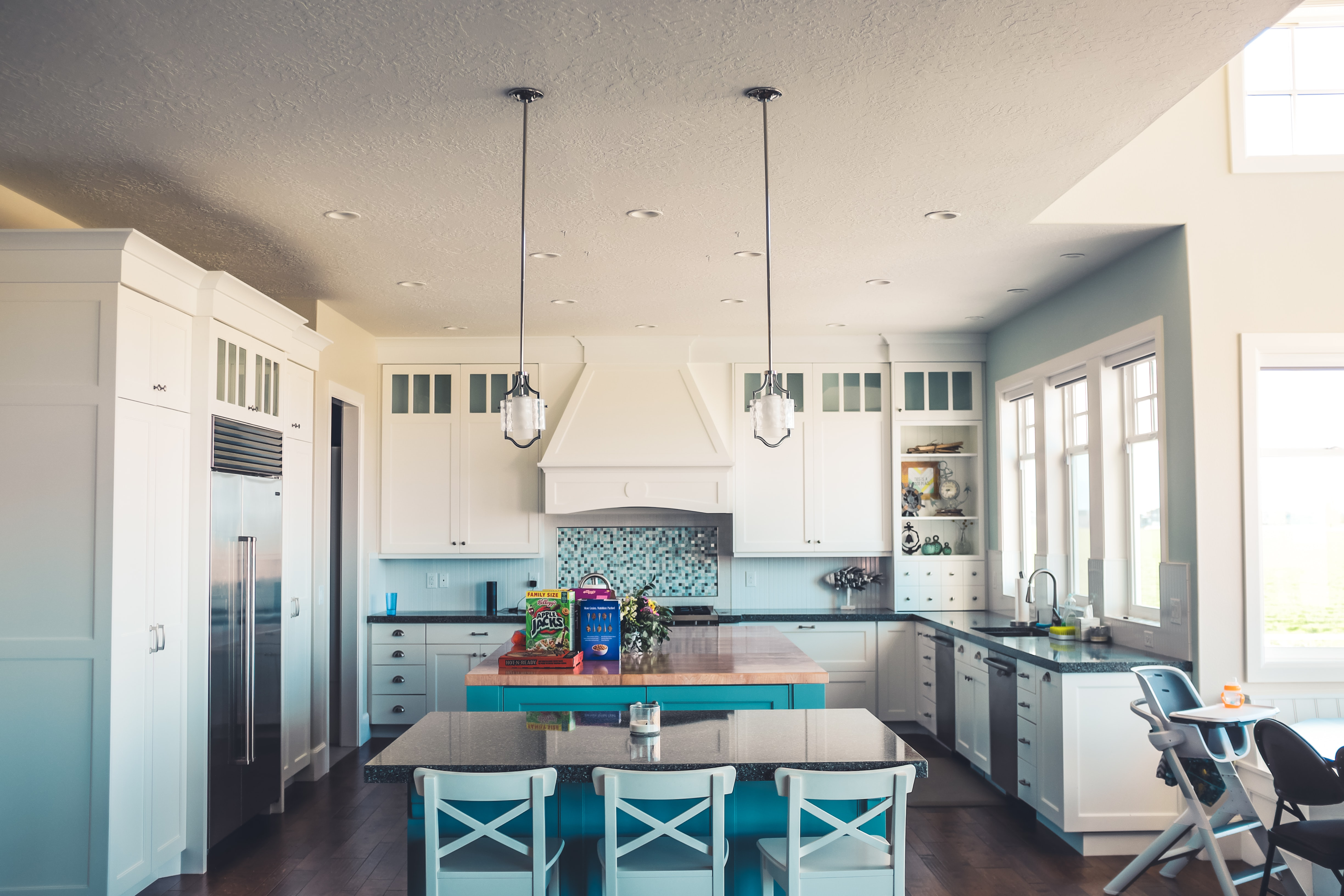 Blue And White Kitchen Interior With Open Concept With Island And Large  Windows
