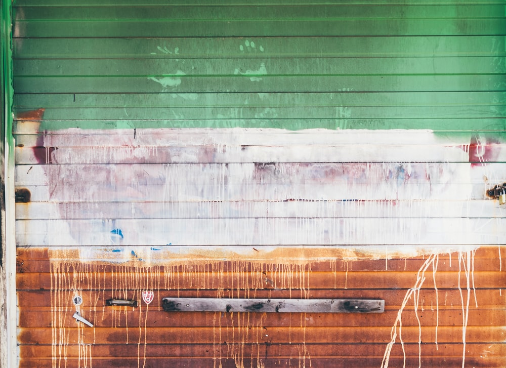 wooden wall with brown and green paint