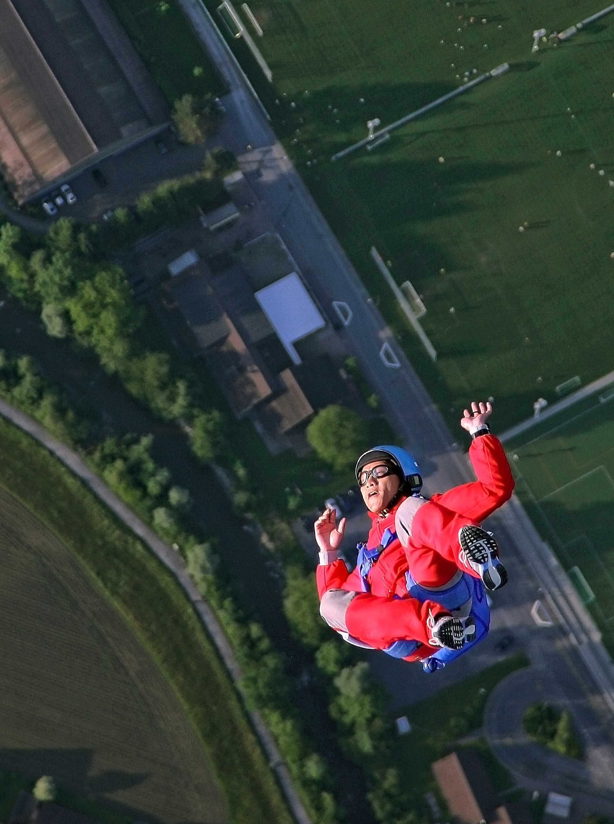 An aerial photo of a person falling toward the ground as they skydive in Zug