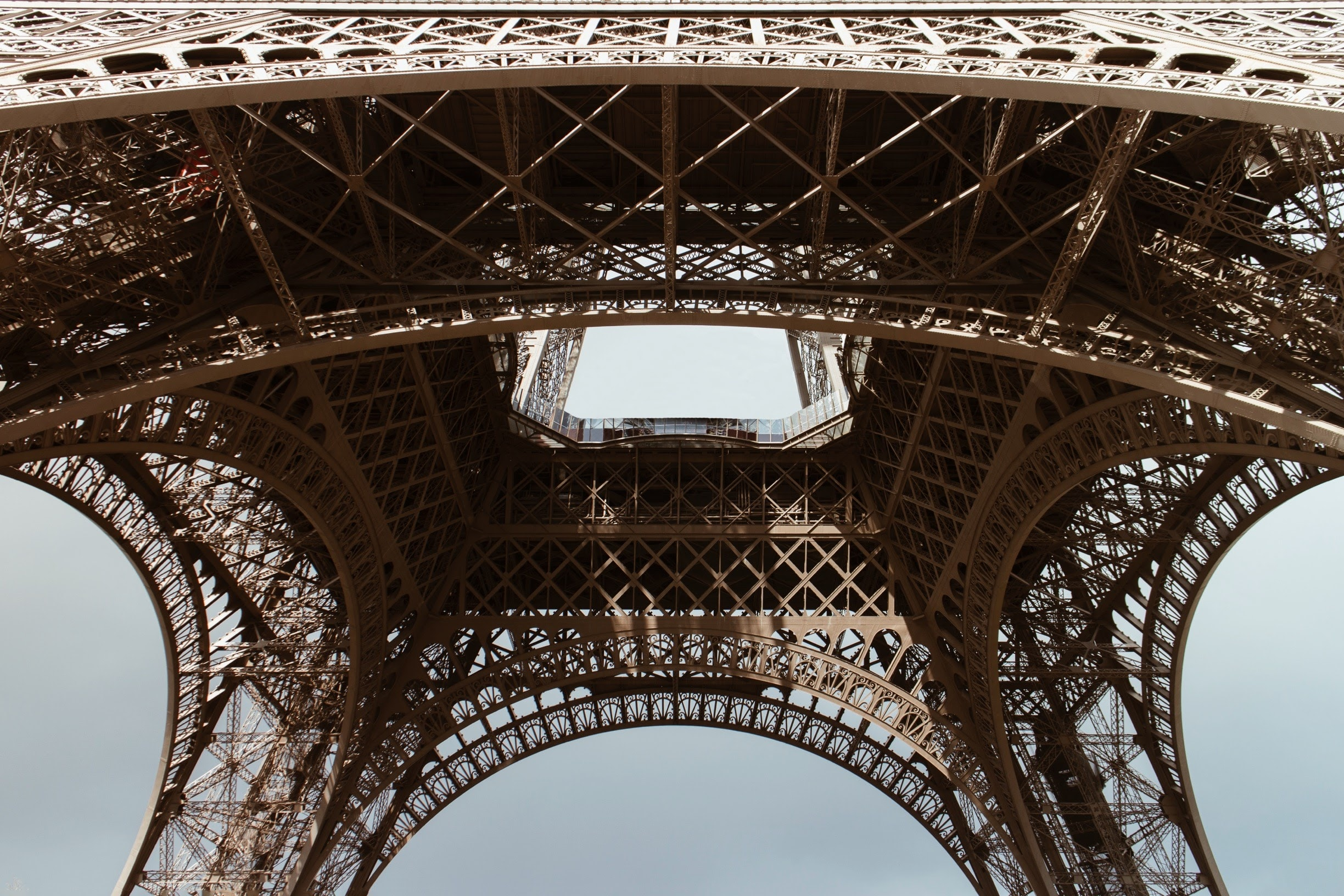 Looking up at the Eiffel Tower from underneath it