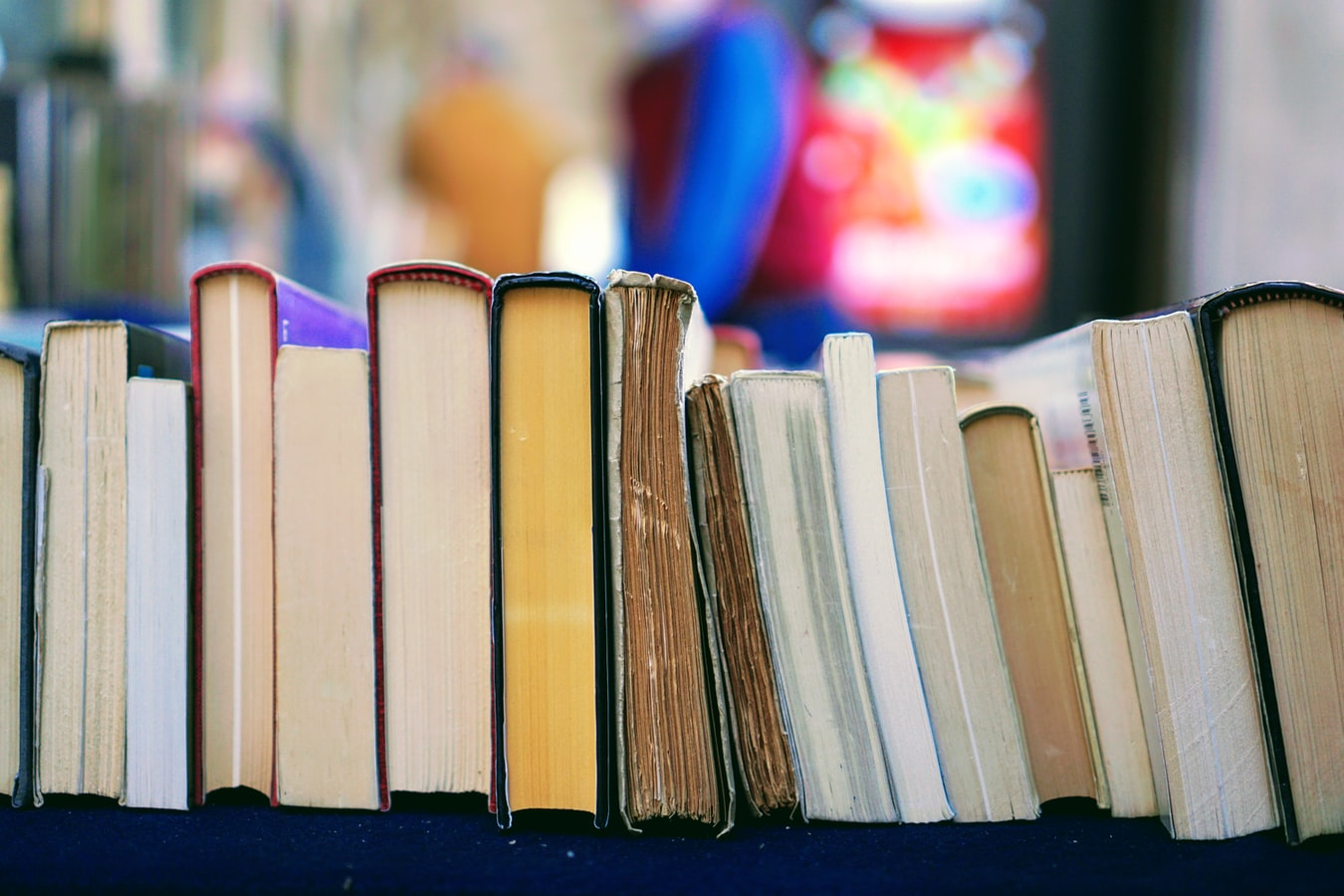 A bookshelf of old and new books.