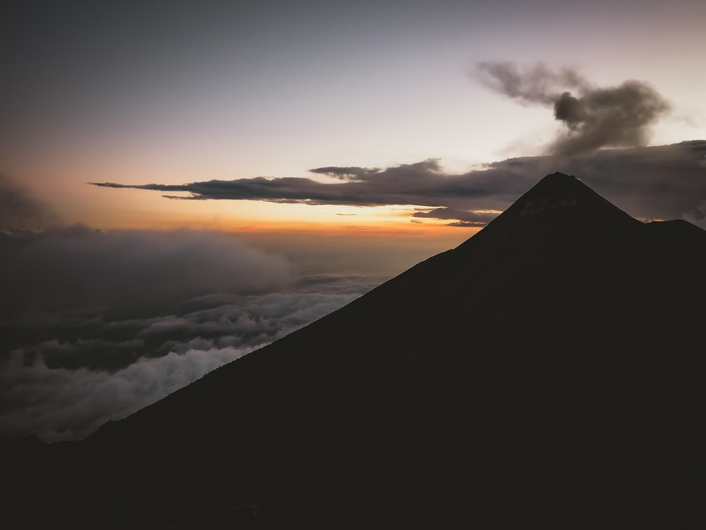 silhouette of mountain with clouds