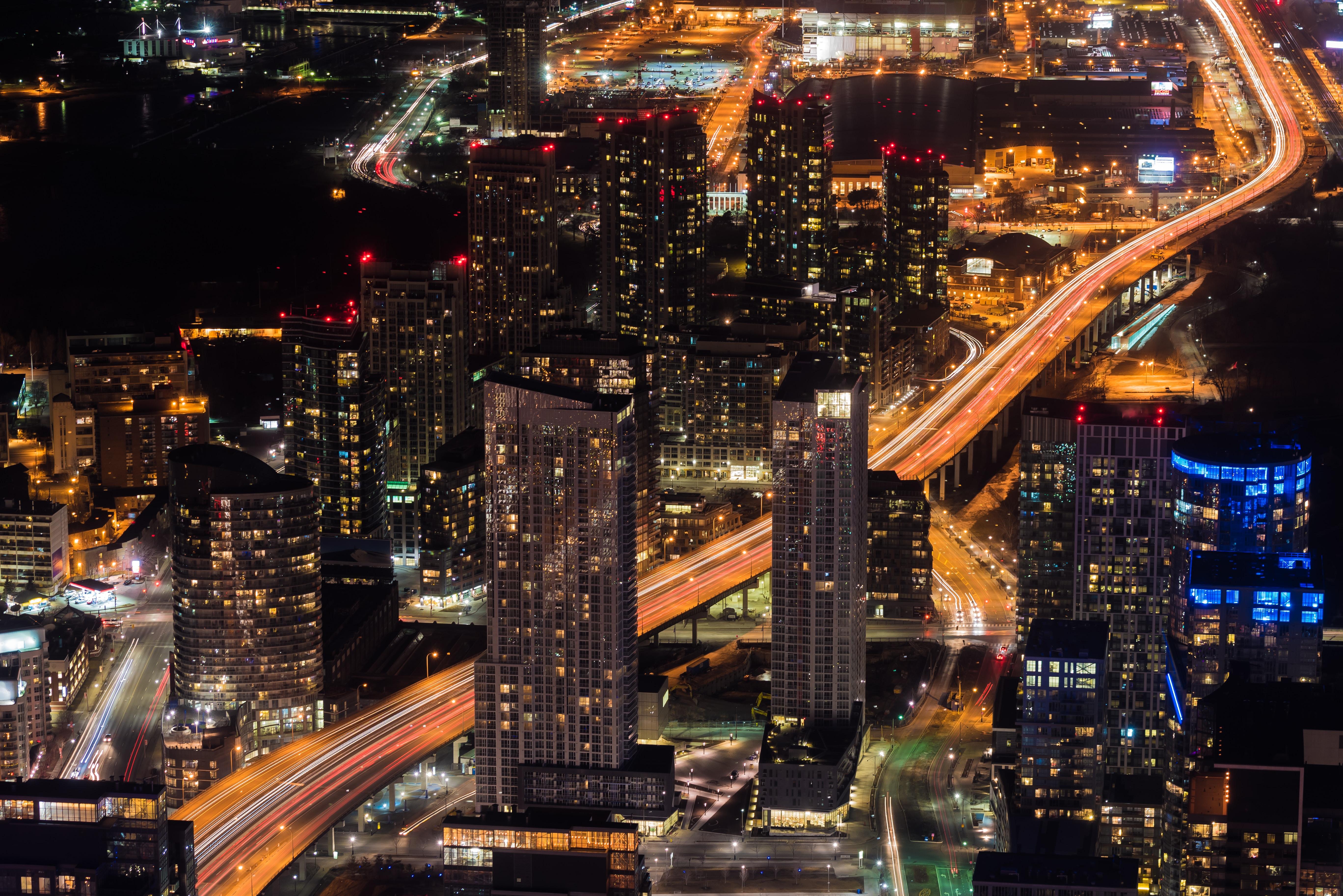 Aerial drone shot of a bustling metropolis at night