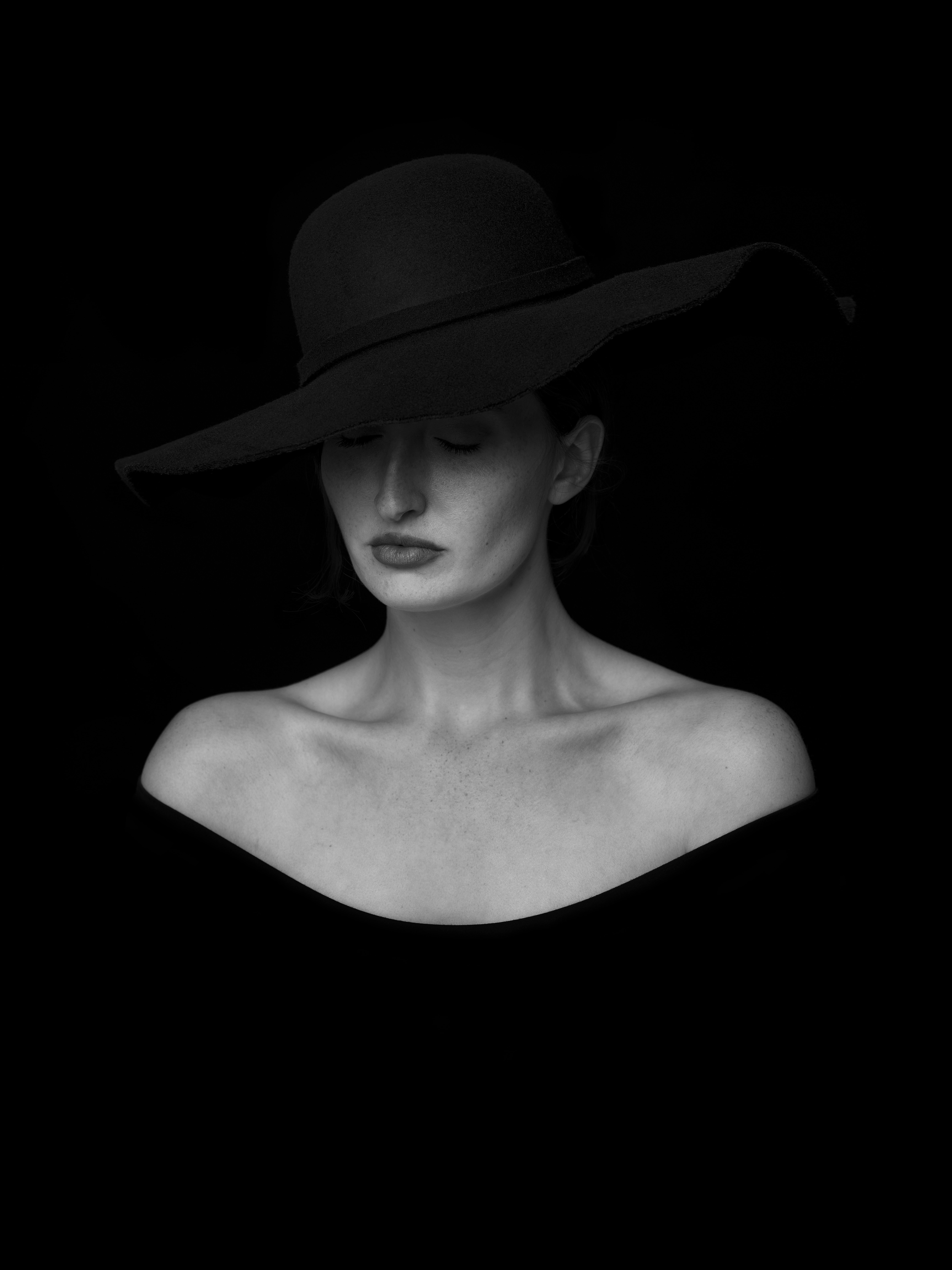 woman in black hat