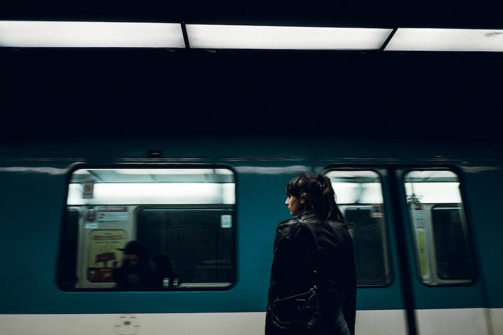 woman standing near closed train door