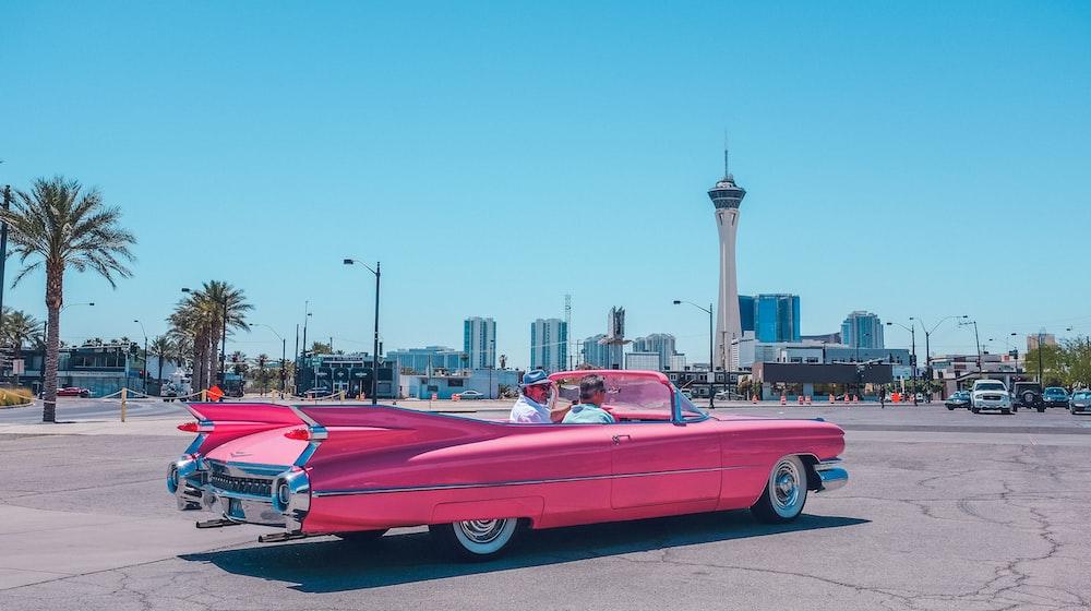 people riding pink car