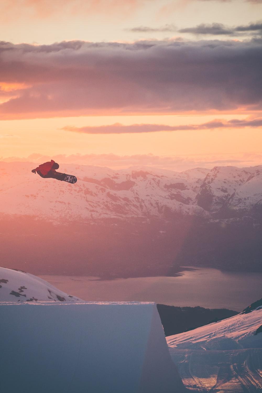 person snowboarding on mountain