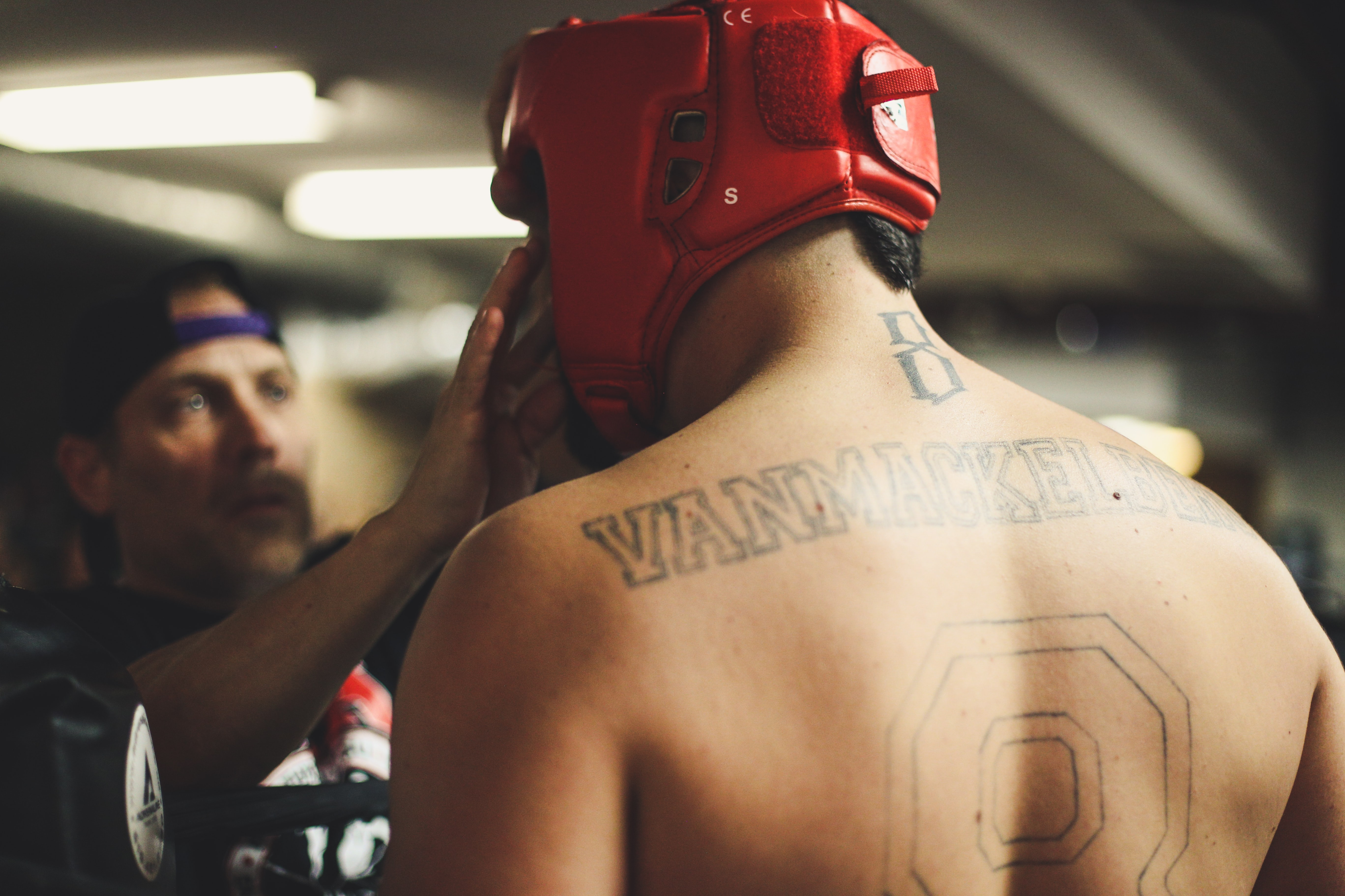 A boxer in a mask with a tattooed prepares for a fight in London