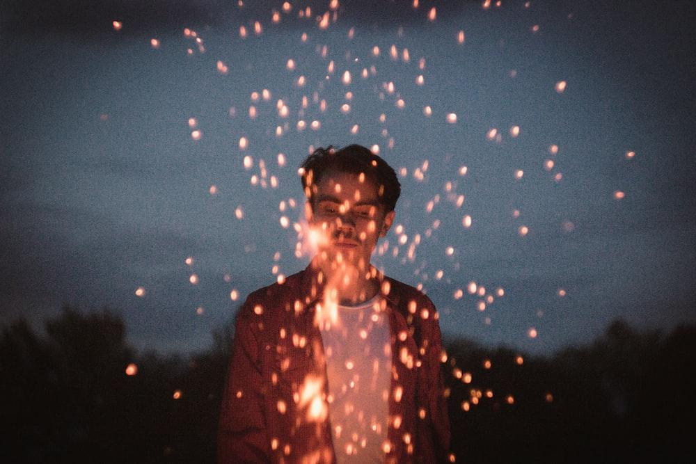 man holding sparkler