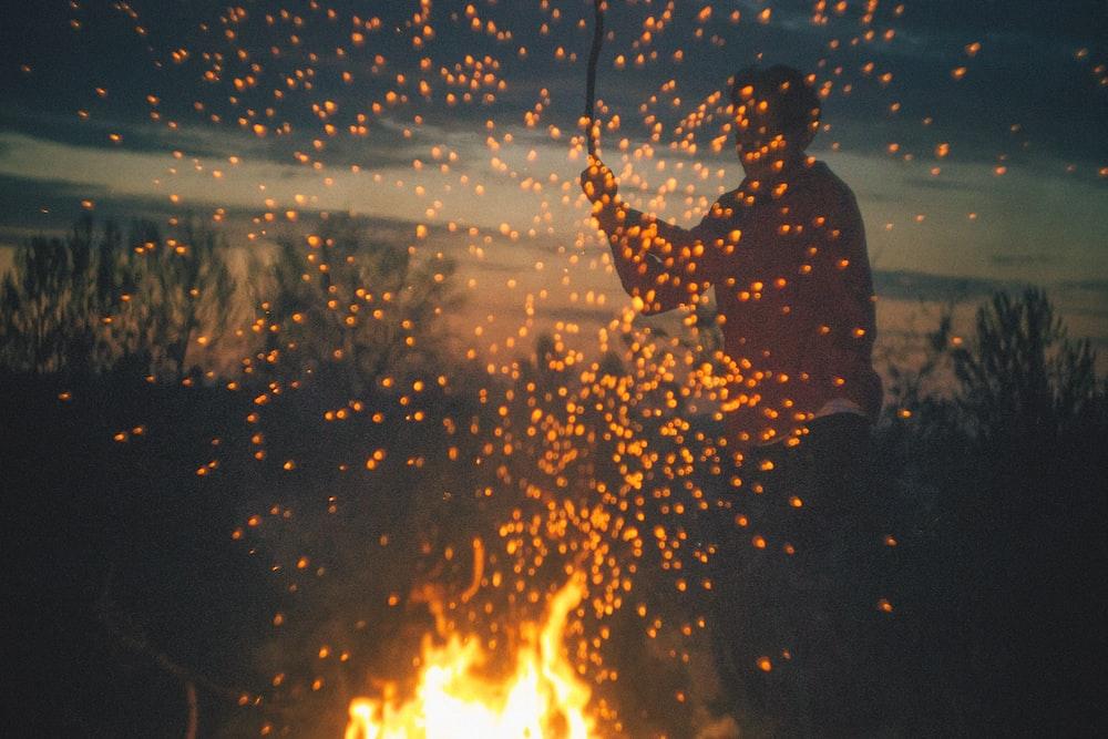man playing bone fire