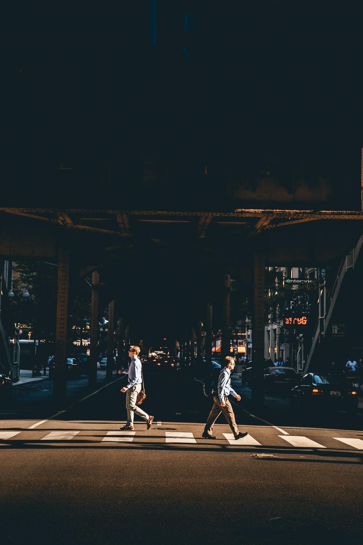 two man crossing at pedestrian lane