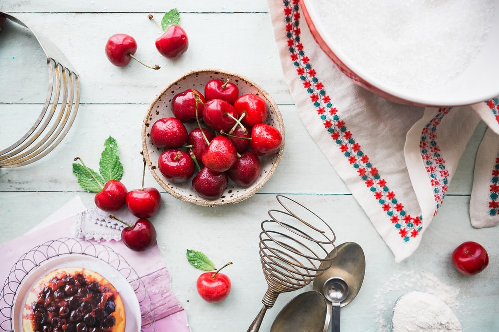 red berries in bowl on table