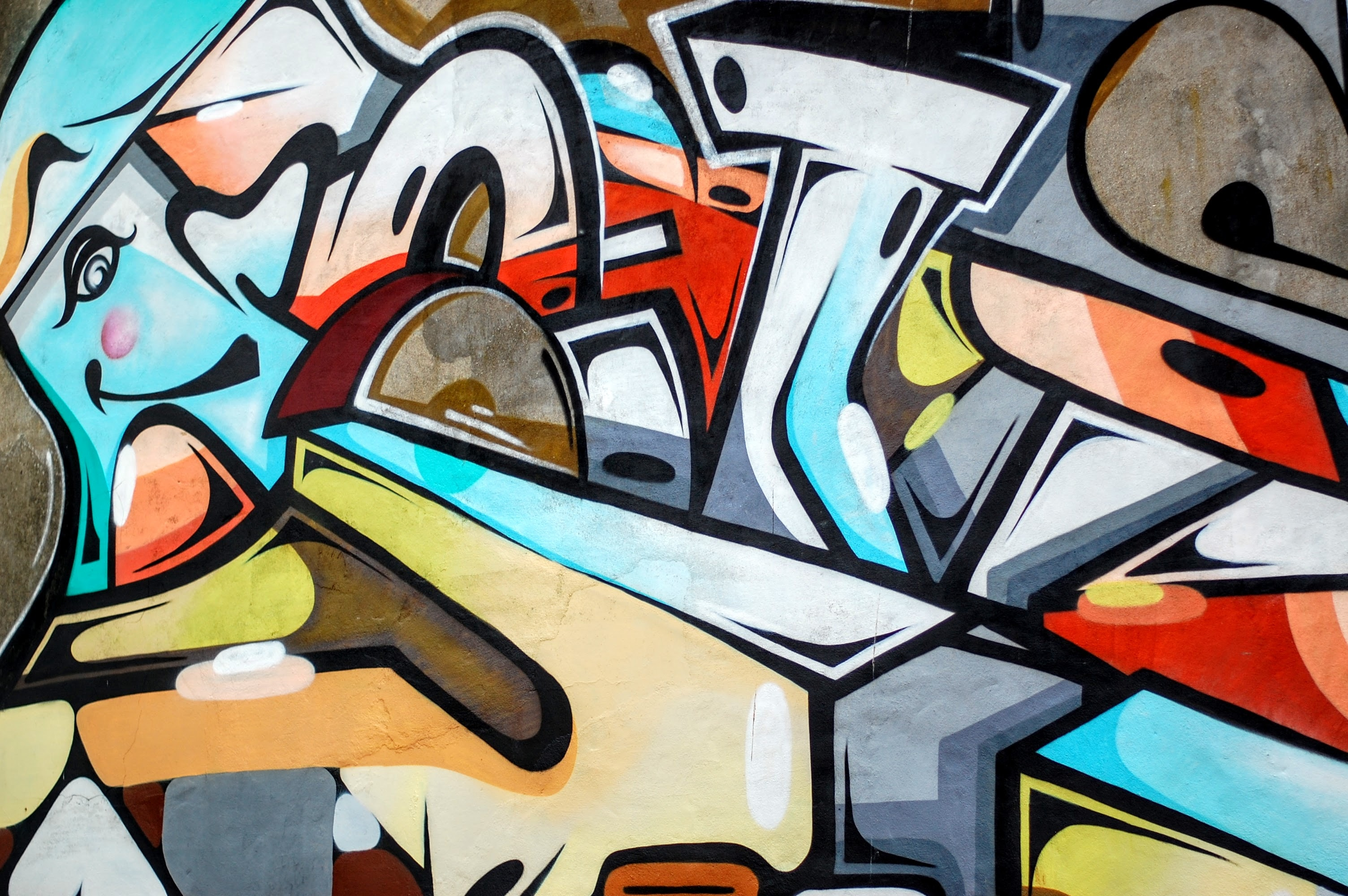 Colorful, wacky, trippy street art graffiti on wall in Bristol