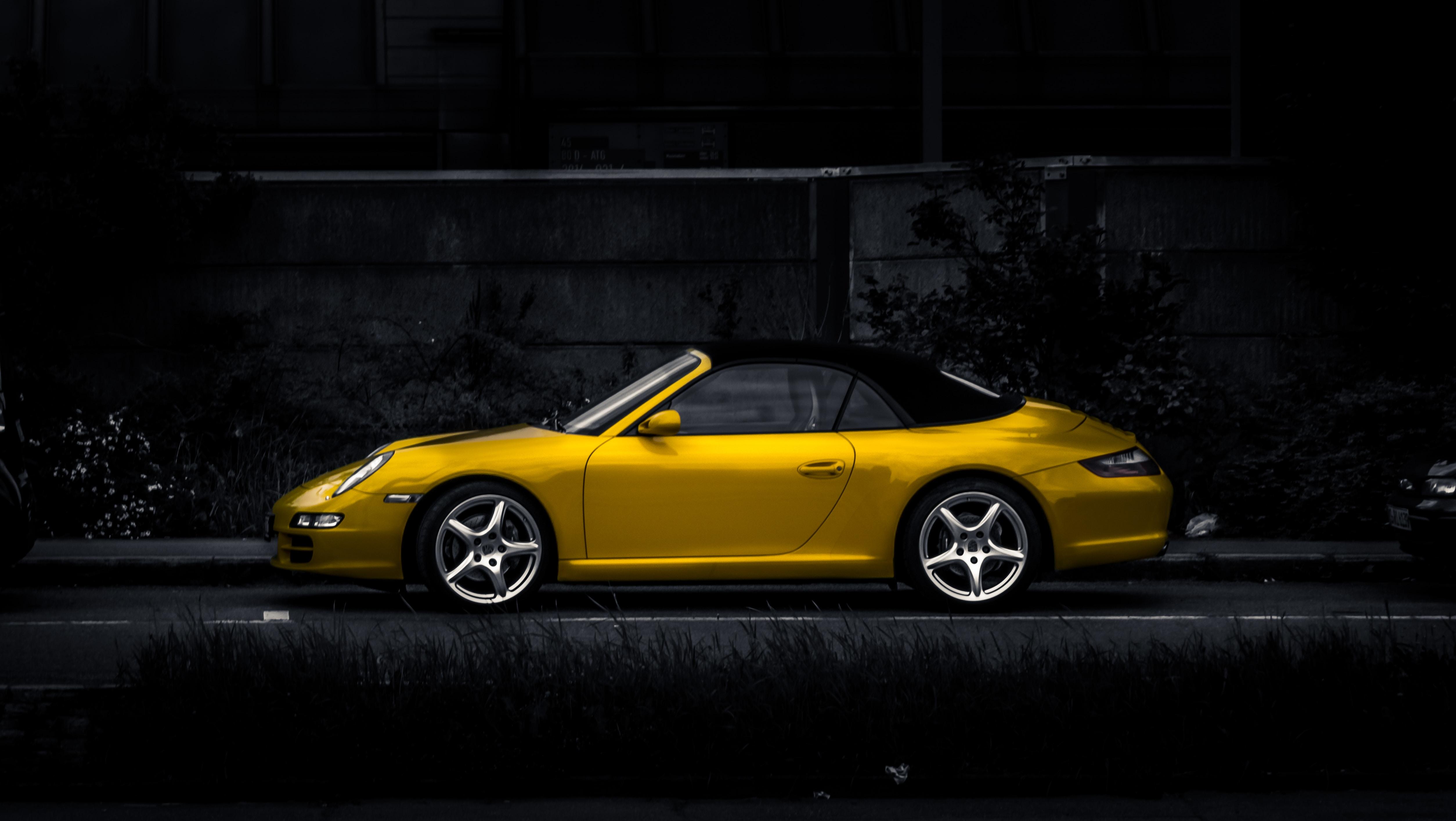 Yellow luxury convertible with dark background