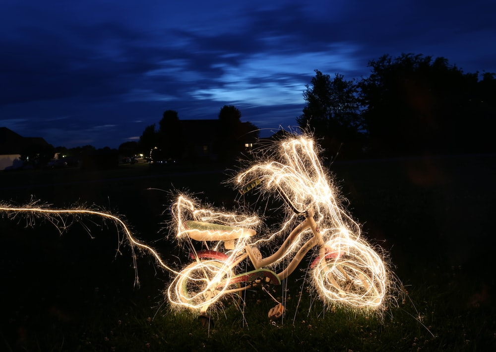 timelapse photograph of bicycle string lights