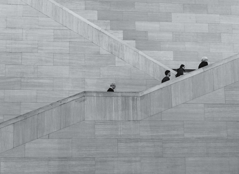 four person walking on stair sketch